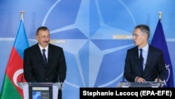 BELGIUM -- Azerbaijani President Ilham Aliyev (L) and NATO Secretary-General Jens Stoltenberg give a press conference at the end of a meeting at NATO headquarters in Brussels, November 23, 2017