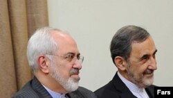 علی اکبر ولایتی، مشاور رهبر جمهوری اسلامی و محمدجواد ظریف، وزیر خارجه ایران