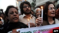Activists and supporters of slain Punjab Governor Salman Taseer march in tribute during a rally in Karachi on January 5.
