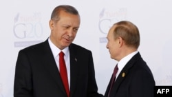 Relations between Erdogan (left) and Russian President Vladimir Putin had been strained following the downing of a Russian jet on the Syrian-Turkish border last year.