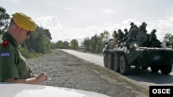 An officer from the OSCE Mission to Georgia observes the withdrawal of Russian troops, October 2008.