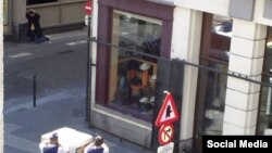 A picture from Brussels released on social media. (The suspected bomb suspect is in the top left corner of the image)