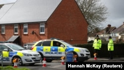 British police guard the home of former Russian intelligence officer Sergei Skripal in Salisbury.