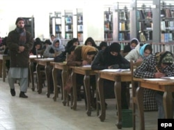 Afghan girls take a university admissions test in Kabul.