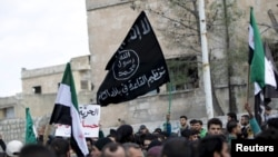 An Al-Qaeda flag flying in Syria's Idlib Province, where Syria's Al-Qaeda affiliate is strong.