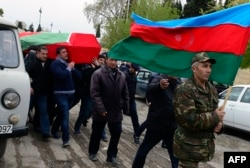 Men carry the coffin of an Azerbaijani serviceman who was killed on April 2 during clashes between ethnic Armenian and Azerbaijani forces in Nagorno-Karabakh.