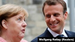 Emmanuel Macron și Angela Merkel