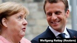 French President Emmanuel Macron (right) and German Chancellor Angela Merkel (file photo)