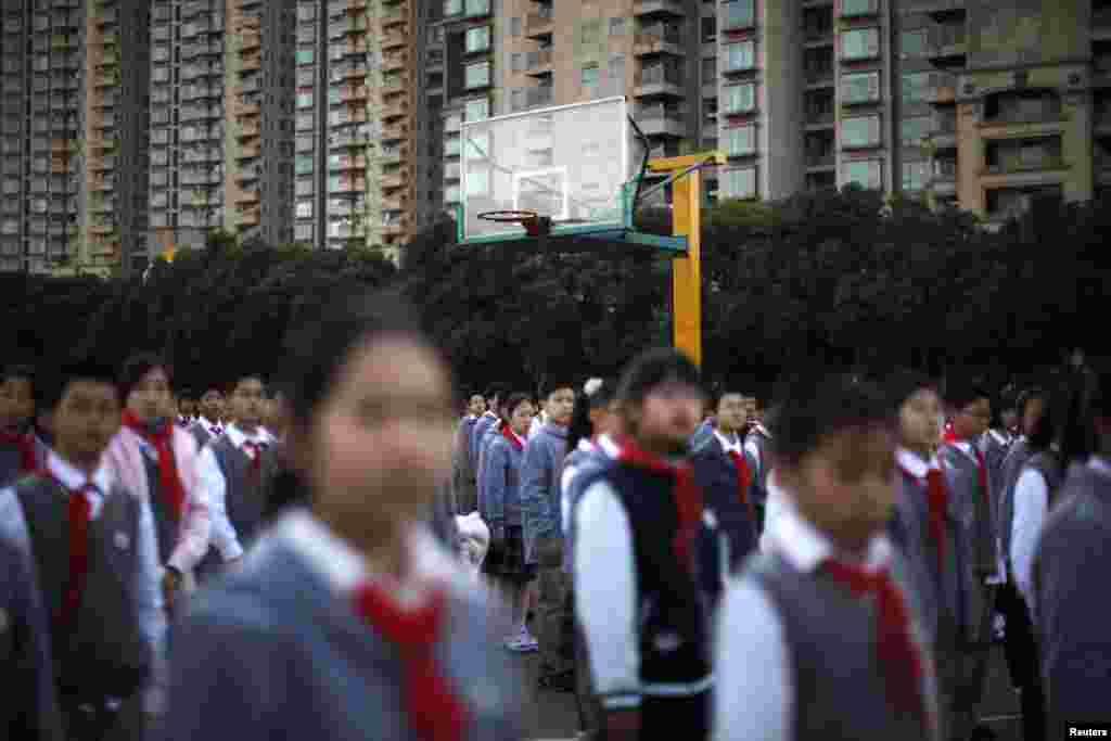 Young Pioneers gather during a flag-raising ceremony at the East Experimental School in Shanghai.