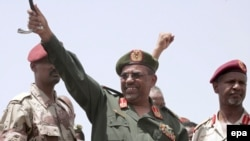 Sudanese President Omar al-Bashir (center) in Khartoum in May