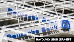 (FILE) - A double exposure picture shows the logo of Deutsche Bank in Berlin, Germany, 25 April 2019