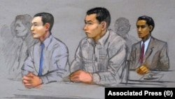 A court artists drawing of Azamat Tazhayakov (left), and Dias Kadyrbayev (center) during their trial for trying to conceal evidence in the case against convicted Boston Marathon bomber Dzhokhar Tsarnaev. (file photo)