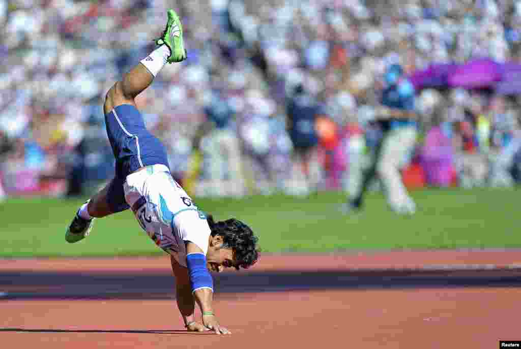 Ahmed Naas of Iraq performs a cartwheel in celebration as he throws in the men's F40 classification javelin final at the London 2012 Paralympic Games. (Reuters/Toby Melville)