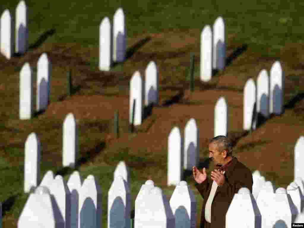 A man prays among graves of thousands of killed Bosnian Muslims at a cemetery in Potocari near Srebrenica on the first day of Eid al-Adha on November 16. Muslim survivors of the Srebrenica massacre, in which Serbian forces killed up to 8,000 Muslim men and boys, gathered in their deserted town to celebrate Eid al-Adha. Photo by Dado Ruvic for Reuters