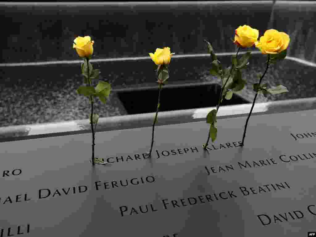 Roses are stuck in the name of Richard Joseph Klares, who was killed in the attack on the World Trade Center, at the National 9/11 Memorial site in New York.