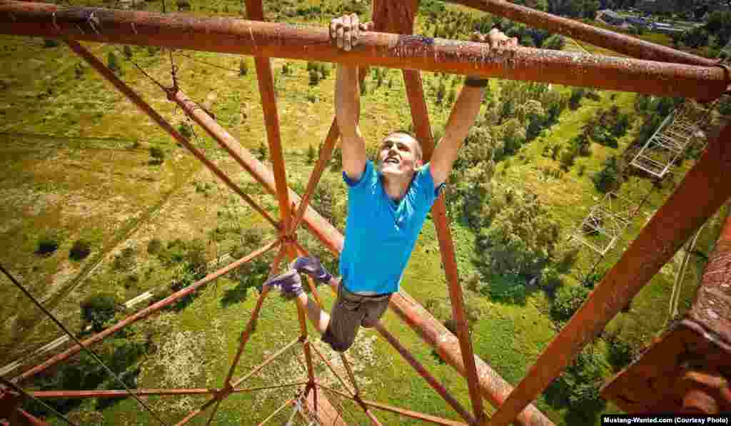 Hanging from a steel tower