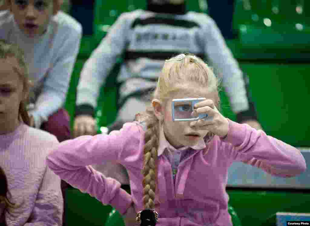 A girl suffering from partial blindness participates in a special sporting event for disabled and orphaned children in St. Petersburg in March 2012.