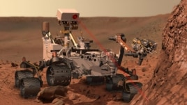 "An artist's concept depicts the rover ""Curiosity,"" of NASA's Mars Science Laboratory mission, as it uses its Chemistry and Camera (ChemCam) instrument to investigate the composition of a rock surface."