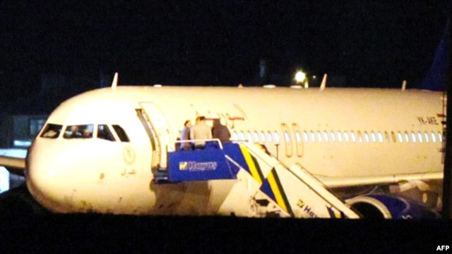 The Syrian passenger plane is seen after it was forced to land at Ankara airport on October 10.