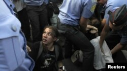 Russian police detain opposition activists during a protest rally in central Moscow on August 12.