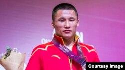 Член сборной Китая Ерланбек Катейулы на отборочных соревнованиях в Астане. 19 марта 2016 года. (Автор фото Женис Искакбай).