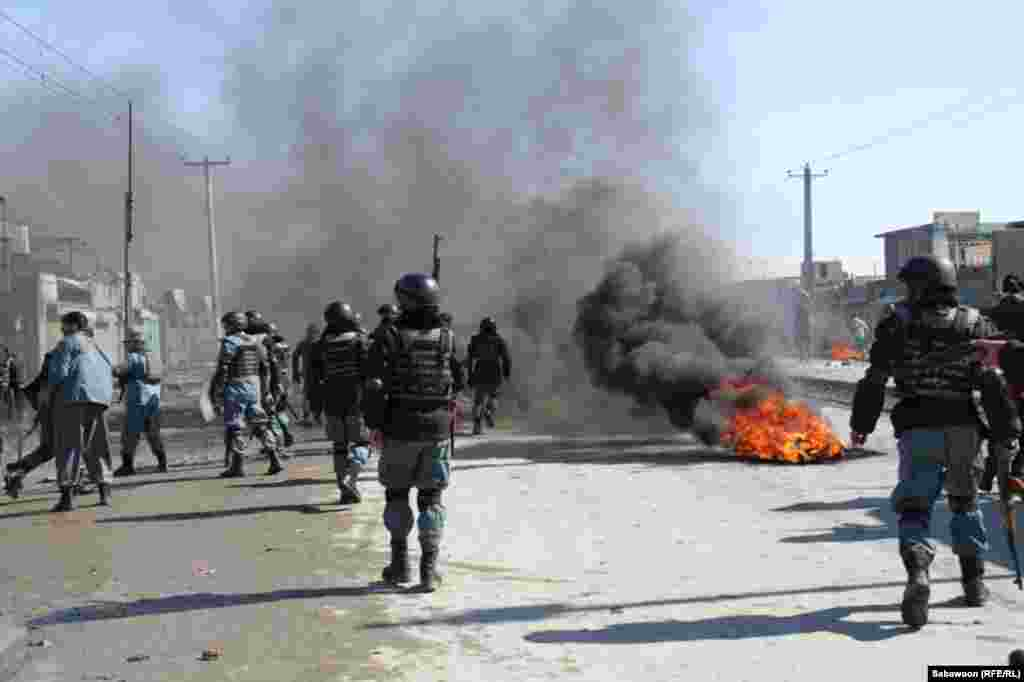 Security forces try to disperse a protest in Kabul at which tires were being burned.