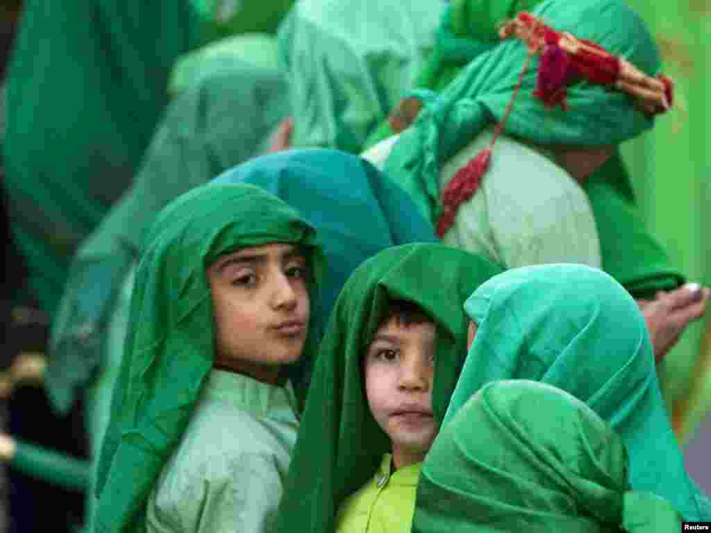 Children taking part in a religious passion play walk in the streets of Tehran during Ashura on December 15. Shi'a all over the world mourn the slaying of Imam Hussein during the first 10 days of the Islamic month of Muharram. Photo by Caren Firouz for Reuters