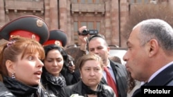 Armenia -- National police chief Alik Sargsian (R) argues with opposition MP Zaruhi Postanjian outside the government building in Yerevan, 10Mar2011.