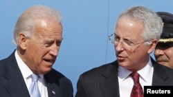 As Vice President, Joe Biden (left) speaks to U.S. Ambassador to Pakistan Cameron Munter in 2011. (file photo)