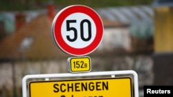 Luxembourg -- A street sign marks the beginning of the village of Schengen, January 27, 2016