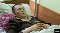 Aleksandr Aleksandrov, one of two captured Russian soldiers, in a Kyiv hospital on May 19.