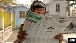 Ооганстанда АКШ президенти Барак Обаманын сүрөтү басылган кайрылуусун окугандар көп. 2-декабр, 2009-ж.