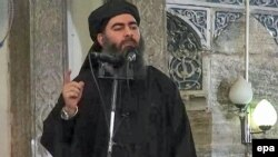 An image purportedly shows the caliph of the self-proclaimed Islamic State, Abu Bakr al-Baghdadi, giving a speech in an unknown location