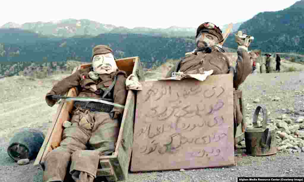 "Dummies of Soviet soldiers. The sign reads, ""The sisters of Shahr-e Naw"" -- a neighborhood in Kabul -- ""are crying, while the sisters of communists are prettying up their eyes."""