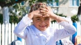 Moldova - Bursuc school, girl in the first form, 18Sep2009
