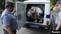 Russia - Police detain a street prostitute in Russia's Siberian city of Krasnoyarsk, 20Jul2011