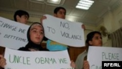 Children in Peshawar declare their support for Obama.