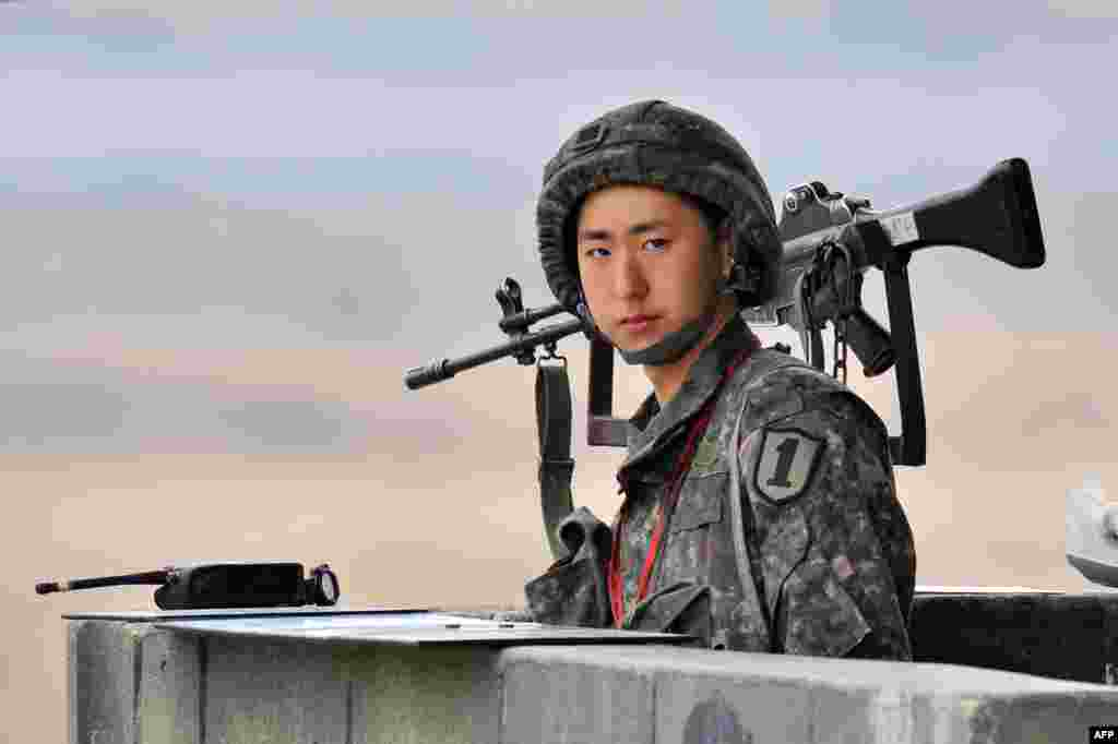 A South Korean soldier stands at a military guardpost near the demilitarized zone (DMZ) dividing the two Koreas in the border city of Paju, amid rising tensions with Pyongyang. (AFP/Jung Yeon-Je)