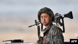 A South Korean soldier stands on guard near the demilitarized zone dividing the two Koreas on April 5.