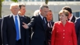 Belgium - (L-R) U.S. President Donald Trump, NATO Secretary General Jens Stoltenberg and German Chancellor Angela Merkel gather with NATO member leaders to pose for a family picture before the start of their summit in Brussels, Belgium, May 25, 2017