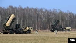 US troops from the 5th Battalion of the 7th Air Defense Regiment emplace a launch station of the Patriot air and missile defence system at a test range in Sochaczew, March 21, 2015