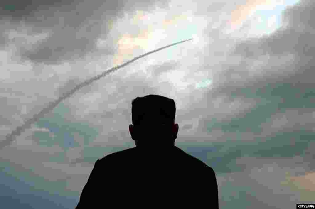 North Korean leader Kim Jong Un watches the launch of a ballistic missile at an unknown location on July 31. (AFP)