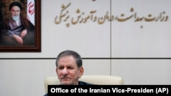 IRAN -- Iran9an Senior Vice-President Eshaq Jahangiri sits in front of a painting of the late revolutionary founder Ayatollah Khomeini during a top-level meeting on prevention and combating the coronavirus, in Tehran, 28 February, 2020