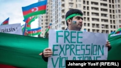 Azerbaijan -- A demonstrator joins a rally protesting the crackdown against civil society in Azerbaijan. 09Nov2014
