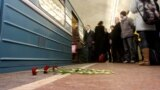 Russia--Flowers lay in memory of victims of a terrorist bomb blast inside the Lubyanka metro station in Moscow on March 29, 2010 where the line has resumed running after the morning's incident, 29Mar2010