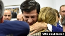 Kakha Kaladze celebrates after exit polls gave him the victory in the Tbilisi mayor's race.