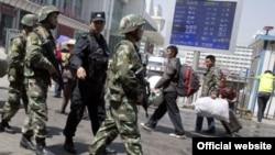 Сотрудники китайских сил безопасности. Иллюстративное фото.