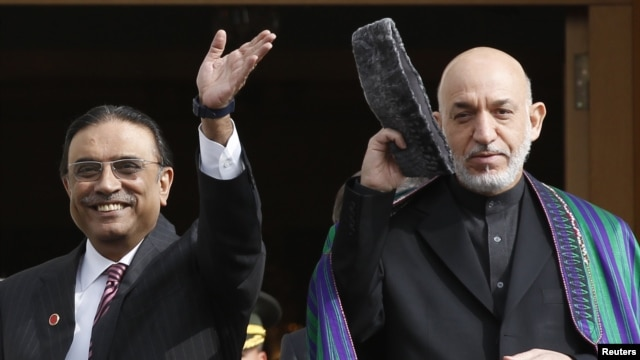 "Pakistani President Asif Ali Zardari (left) told his Afghan counterpart, Hamid Karzai, that Pakistan was committed ""to concrete action to eradicate the menace of terrorism and extremism."""