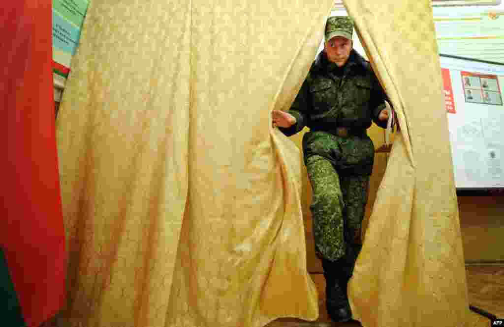 A Belarusian military cadet leaves a polling booth after casting his ballot during early voting for the country's presidential election in Minsk on October 7. (AFP/Sergei Gapon)