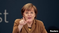 Greece -- German Chancellor Angela Merkel speaks during a forum with Greek entrepreneurs in Athens, April 11, 2014